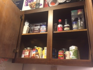 On the top left is a bin with boxes of baking soda, cocoa, etc., and the right is the stackable shelves with small spices.
